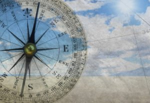 Multiple Exposure Of Compass And Scene From Remote Desert