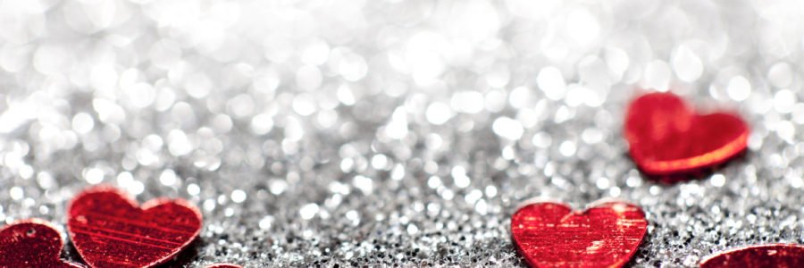 Macro photography of defocused Lights and glitter hearts